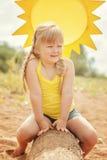 Charming blond girl posing sitting on log Royalty Free Stock Photo