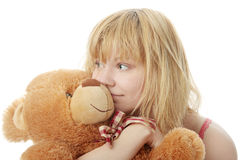 Charming blonde. In bed embraces teddy bear isolated Stock Photo
