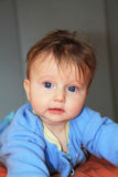 Charming blonde baby with blue eyes Stock Photos