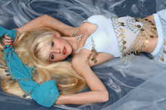 Charming blonde in a blue dress Stock Photos