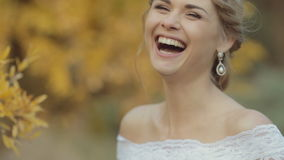 Charming blonde bride smiling and laughing. Near bright yellow tree stock video