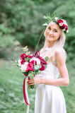 Charming blonde bride with tender autumn flowers in her hair Royalty Free Stock Images