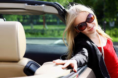 Charming blonde and the car.  stock images