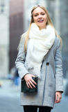 Charming blonde on a city street Royalty Free Stock Photography