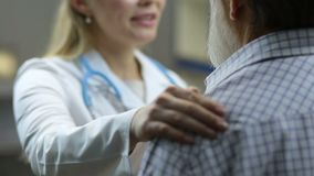 Positive physician telling good news to patient stock footage