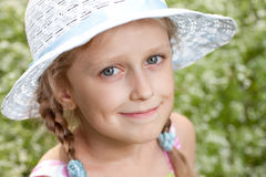 Charming blonde girl in a hat Royalty Free Stock Photos