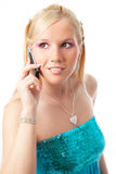 Charming blonde girl with mobile. On isolated white background royalty free stock image