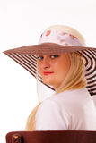 Charming blonde lady in a hat Stock Photos