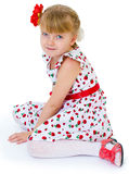 Charming blonde little girl look. Stock Photo