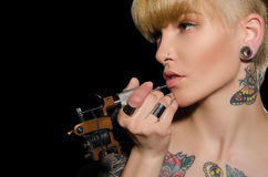 Charming blonde makes herself tattoo Royalty Free Stock Photo