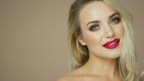 Charming blonde model with red lips stock footage