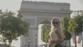 Charming blonde posing near the Arc de Triomphe in Paris stock footage
