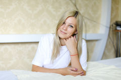 Charming blonde smiles and poses for camera, located in sleeping stock image