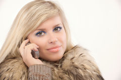 Charming blonde speaks by phone Stock Photography
