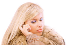 Charming blonde speaks by phone Royalty Free Stock Images