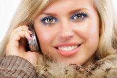 Charming blonde speaks by phone Stock Image