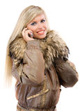 Charming blonde speaks by phone Royalty Free Stock Photo