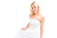Charming blonde in a white wedding dress Stock Photo