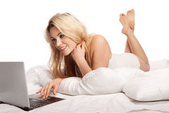 Charming blonde woman using a laptop Stock Photo