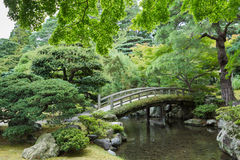 Charming bow bridge at Imperial Palace. Kyoto, Japan - September 14, 2016: Part of the Japanese garden at the Imperial palace showing bow bridge, pond, and Royalty Free Stock Photo