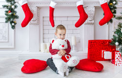 The charming boy with a big polar toy bear. Stock Photography