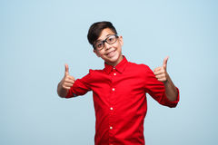 Charming boy gesturing thumbs up Stock Images