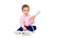 Charming boy talking on the phone. In a business suit on white background royalty free stock photography