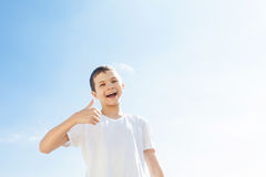 Charming Boy with thumbs up Stock Photography