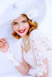 Charming bridal smile. Charming bride wearing elegant lace dress and broad-brimmed hat is happy and laughing. Wedding. Beauty, fashion concept Stock Photos