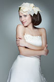 Charming bride. Portrait of charming bride with flower on hair Stock Photos