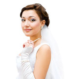 Charming bride. Young charming bride looks into camera, isolated stock photo