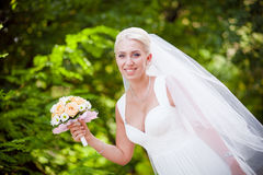 Charming bride with a bouquet Royalty Free Stock Photo