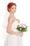 Charming bride with a bouquet of flowers Royalty Free Stock Images