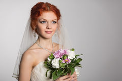 Charming bride with bouquet of flowers Stock Images