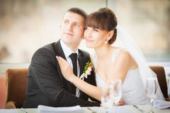 Charming bride and groom on their wedding celebration in a luxur Stock Photos