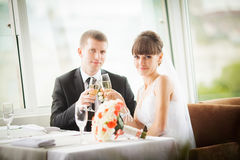 Charming bride and groom on their wedding celebration in a luxur Stock Images