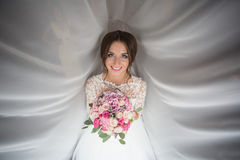 The charming bride keeps a wedding bouquet Stock Photography