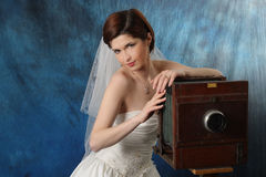 Charming bride with an old camera Royalty Free Stock Photo