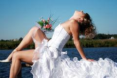 Charming bride relaxing Stock Photography