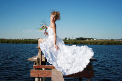 Charming bride relaxing on the sun Stock Photography