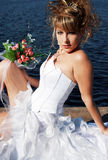 Charming bride relaxing on the sun Royalty Free Stock Image