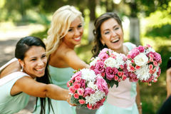 The charming bridesmaids. With rose Royalty Free Stock Photography