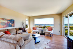 Charming bright living room with walkout deck Royalty Free Stock Photo