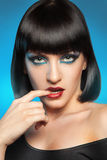 Charming brunette on blue background Stock Images
