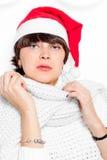 Charming brunette in cap Santa Claus Stock Image