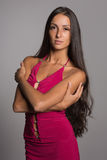 Charming brunette in a crimson dress Stock Photo