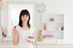 Charming brunette female eating Stock Image