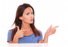 Charming brunette with fingers gesturing a handgun Stock Photos