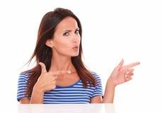 Charming brunette with fingers gesturing a handgun Stock Photos