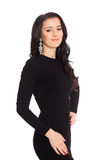 Charming brunette girl in a black dress isolated on white stock images